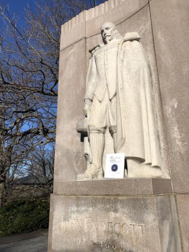 At the feet of John Endecott statue in Boston